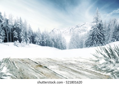 wooden table of free space and winter landscape