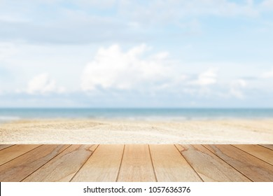 wooden table in front of abstract blurred background of summer beach