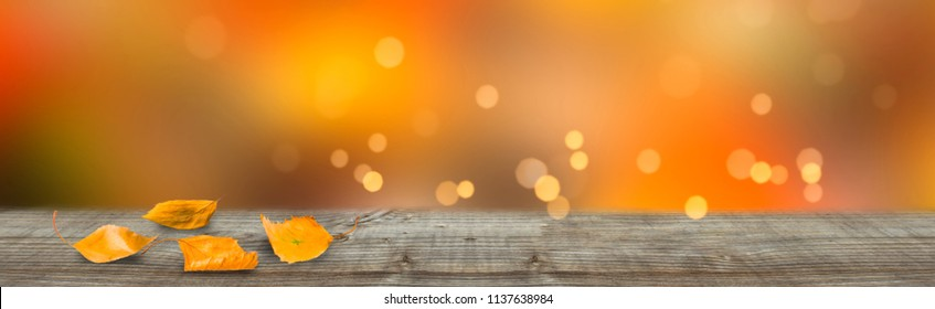 wooden table in front of abstract bright background