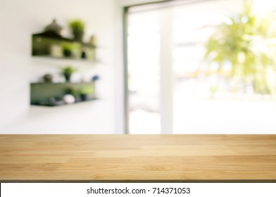 wooden table in front of blurred  background of coffee shop cafe