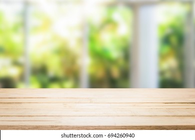 wooden table in the kitchen on the window background in the morning.