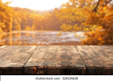 wooden table and lake