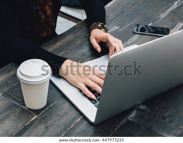 Wooden table with laptop and coffee. Work place.