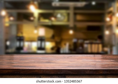 Wooden table on abstract blurred interior restaurant background and free space for decoration display or montage products.