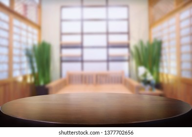 Wooden table on abstract blurred interior background and free space for your decoration display or montage your products.