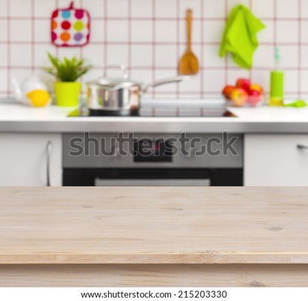 Awe Inspiring Wooden Table On Blurred Kitchen Bench Stockfoto Jetzt Lamtechconsult Wood Chair Design Ideas Lamtechconsultcom