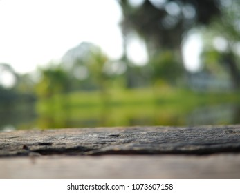 Wooden table on blurred park backgound