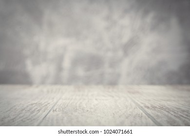Wooden table on concrete wall background