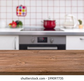 Wooden table on kitchen bench background