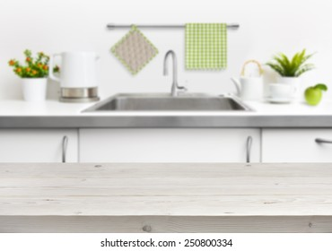 Wooden table on kitchen sink interior background