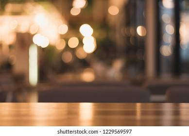 wooden table on light bokeh background in the restaurant