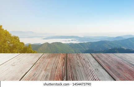 Wooden table on a mountain background, sea fog, used for editing, display products