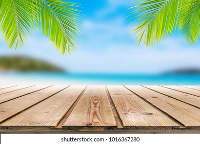 Wooden table on summer beach background for montage or display your products
