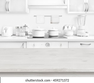 Wooden table on white modern kitchen interior background, pastel colors