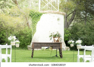 Wooden table in a outdoor wedding.