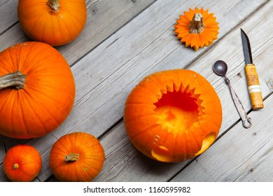 Wooden table with pampkin head jack lantern for halloween
