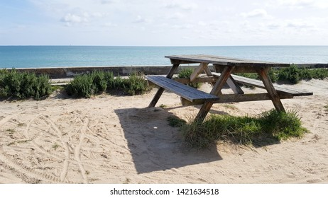 wooden table for picnic on the beach in web banner template