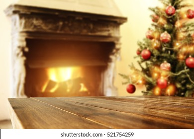 Wooden table place and fireplace with xmas tree