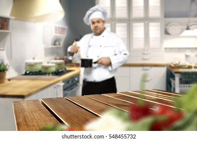 Wooden table place of free space for your decoration and kitchen interior with cook chef