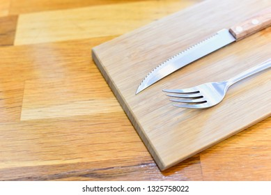 Wooden Table with Stainless Fork and Knife