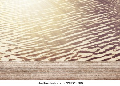 wooden table at the summer background.