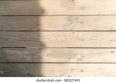 Wooden table with sunlight and shadow