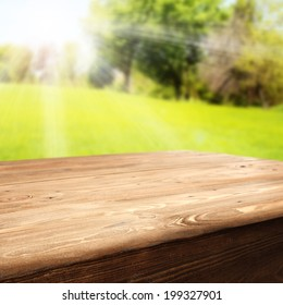 wooden table and sunset in park