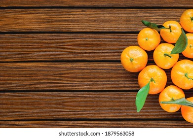 wooden table with tangerines.  winter banner top view