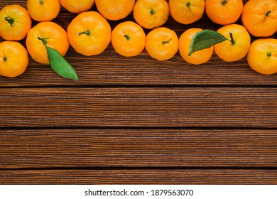 wooden table with tangerines.  winter banner top view.  tangerine frame on wooden surface