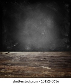 Wooden table top and blank blackboard