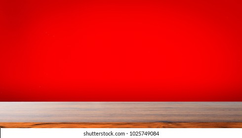wooden table top with color red background use for products show or display