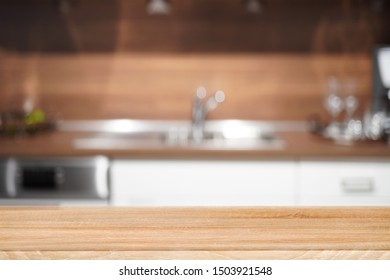 Wooden table top, desk space and blurred of kitchen background. Can be used for product display montage. business presentation.