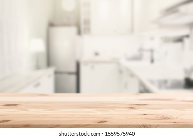 Wooden table top island with blur kitchen home background for products montage advertising.