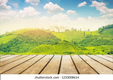 wooden table top with the mountain landscape and blue sky
