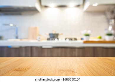 Wooden table top on blur kitchen room background. For displaying the assembly product or visual arrangement of the configuration keys