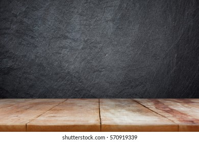 wooden table top on dark gray slate background - can used for display, montage products and business