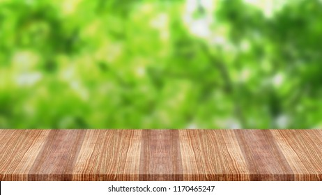 Wooden table top on green nature background