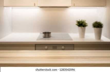 Wooden table top on kitchen island in modern simple home interior. Background for product display montage. Copy space design.