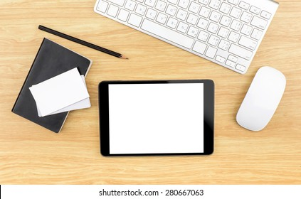 Wooden table top with tablet,black notebook,pencil,keyboard and mouse,Template mock up for business, Clipping path on tablet screen and business card