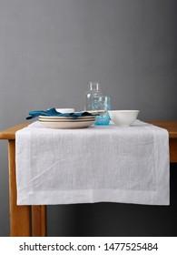 Wooden table and white linen runner