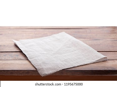 Wooden table with white tablecloth isolated on white. Kitchen background, product montage display. Mock up.