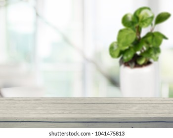 Wooden table with window background