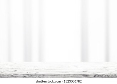 Wooden table and window curtains on a background. Beauty nature background