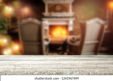A wooden table and a wonderful fireplace in a festive mood