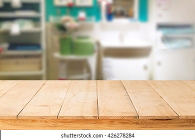 wooden table,mock up interior decoration design  for advertising decoration ready for your product display montage over laundry room decoration background