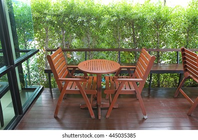 wooden tables and chairs in coffee shop
