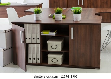 wooden tables and plants in a modern office