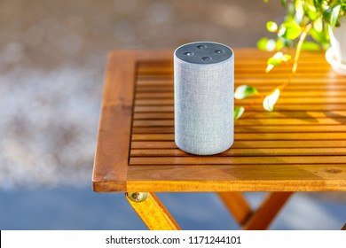 Wooden tables and smart speakers