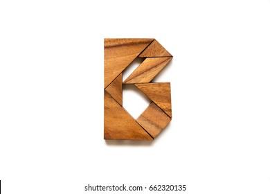 "Wooden tangram puzzle as English alphabet letter ""B"" shape on white background"
