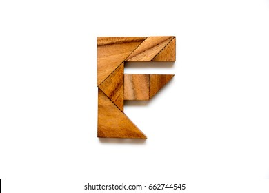 """Wooden tangram puzzle as English alphabet letter """"F"""" shape on white background"""